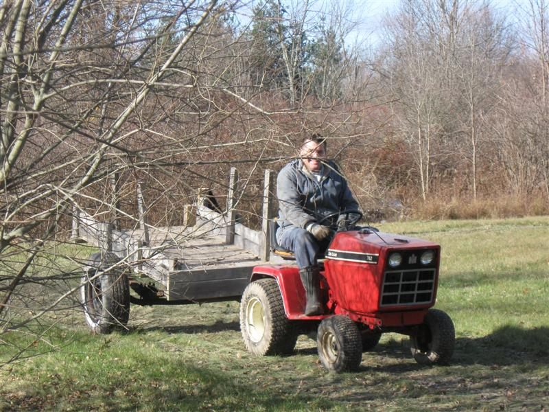 Frank Raso driving a tractor.